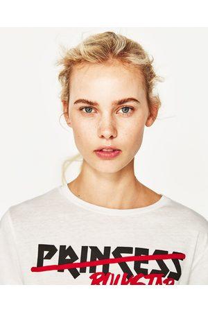 Dames Shirts - Zara T-SHIRT MET KNOOP OP HET VOORPAND - In meer kleuren beschikbaar