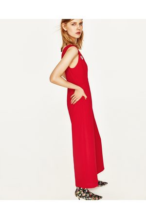 Dames Jumpsuits - Zara CROPPED JUMPSUIT MET METALEN ACCENT