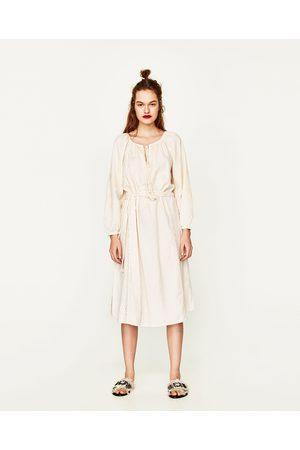 Witte midi jurk