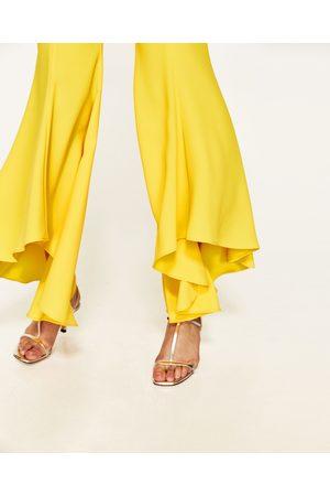 Dames Wijde broeken - Zara BROEK MET WIJDE ASYMMETRISCHE PIJPEN - In meer kleuren beschikbaar