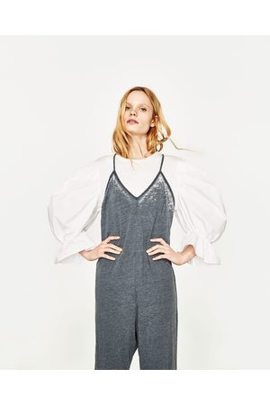 Dames Jumpsuits - Zara JUMPSUIT MET SCHOUDERBANDJES IN USED LOOK