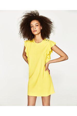 Goud gele jurk