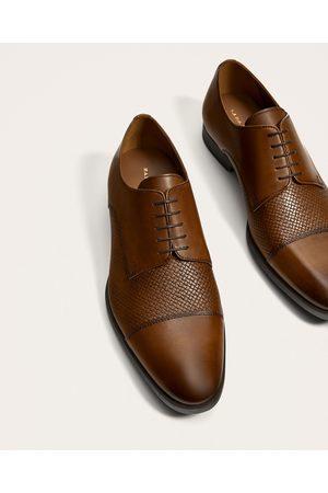kostuum schoenen