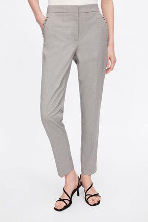 Zara Strakke broek met zakken met volant