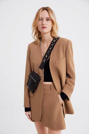 Zara Minirok in klokmodel