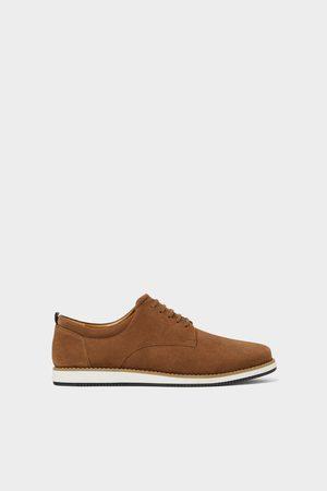 Zara Sportieve schoenen van grijs leer