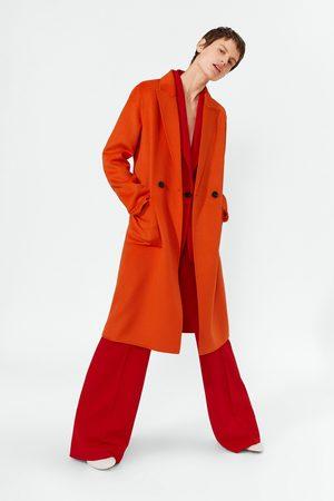 Zara Stoere felgekleurde jas