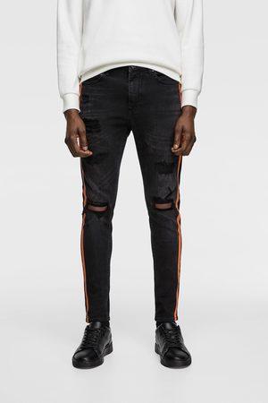 Zara Jeans met gekleurde zijstroken