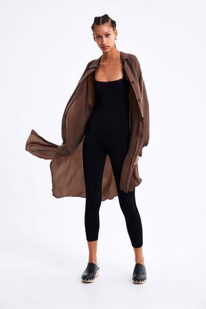 Zara Jumpsuit met schouderbandjes en kantaccent