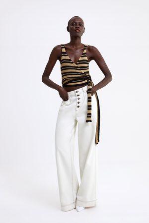 Zara Broek met contrasterende biezen