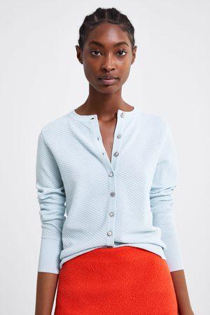 Zara Kort gestructureerde vest met sierknoop