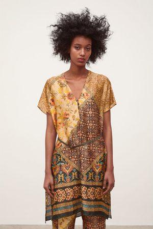 Zara Tuniek met print en riem