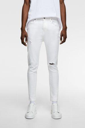 Zara Skinny carrot jeans met scheuren
