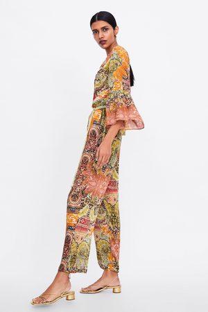 Zara Jumpsuit met print en ceintuur