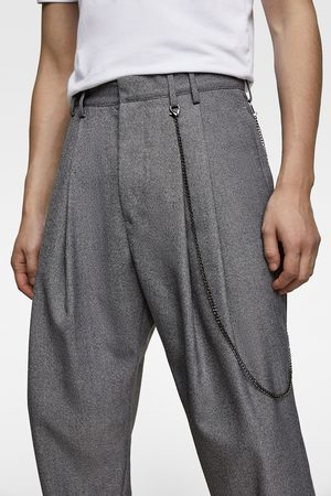 Zara Trousers with pleats and chain detail