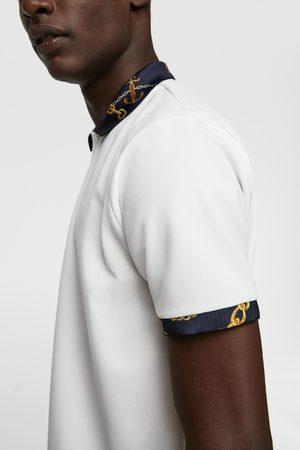 Zara Polo met rib en kettingenprint