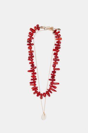 Zara Set van twee kettingen met koraal en schelp