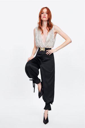 Zara Broek met strikjes