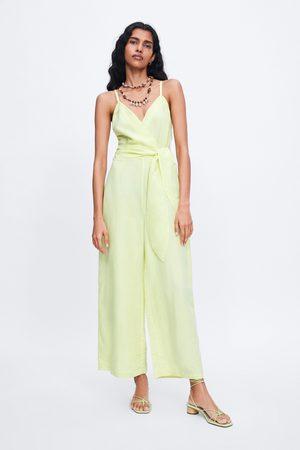 Zara Jumpsuit met schouderbandjes en strik