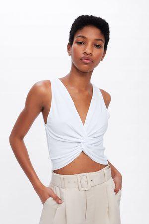 Zara Top met textuur en knoop