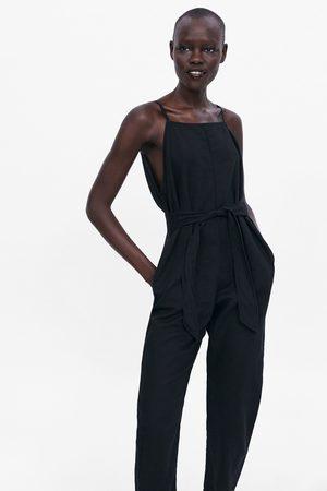 Zara Jumpsuit met schouderbandjes en ceintuur