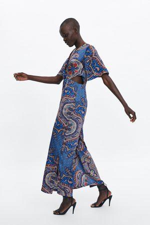 Zara Jumpsuit met print en splitjes