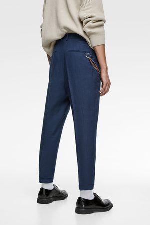 Zara Carrot fit broek met ketting