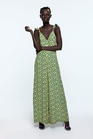 Zara Jumpsuit met schouderbandjes en print