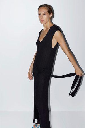 Zara Jumpsuit met overslag en striksluiting