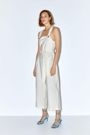 Zara Jumpsuit met split en schouderbanden