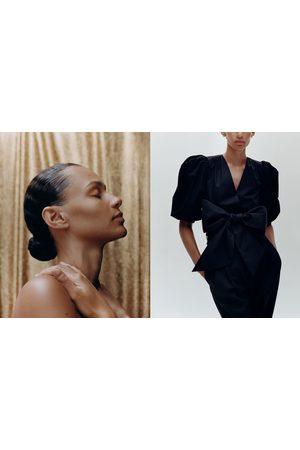 Zara Vest met ballonmouwen en strik