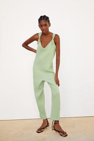 Zara Jumpsuit met textuur en knoopdetails
