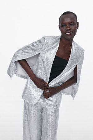 Zara Glanzende cape met splitten