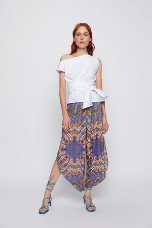 Zara Broek met zakdoekprint