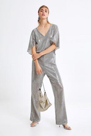 Zara Dames Jumpsuits - Glanzende jumpsuit met capemouwen