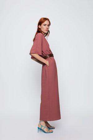 Zara Jumpsuit met overslag en ceintuur