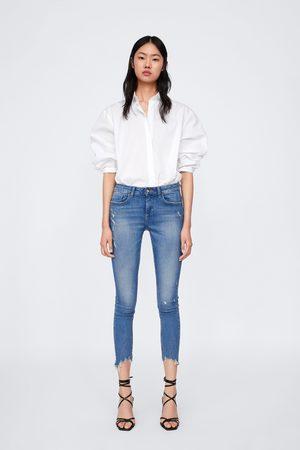 Zara Jeans z1975 met asymmetrische pijpen