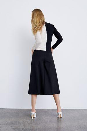 Zara Trui met kleurblok en plooiaccent