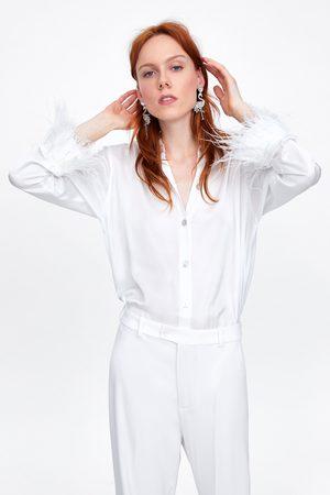 Zara Blouse met veren