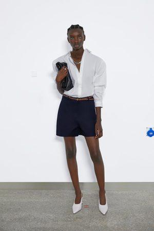 Zara Bermuda met gevlochten riem