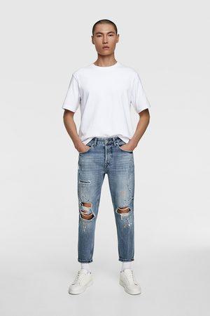 Zara Jeans met scheuren en verfspatten