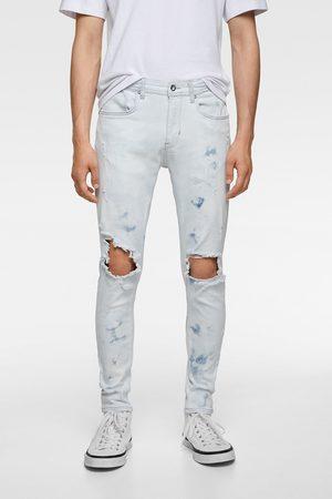 Zara Skinny jeans met scheuren en verfspatten