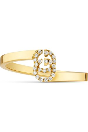 Gucci GG Running ring in yellow gold with diamonds