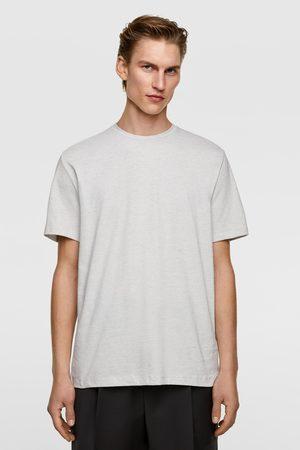 Zara T-shirt met onregelmatige strepen