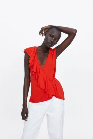 Zara T-shirt met schuine volant