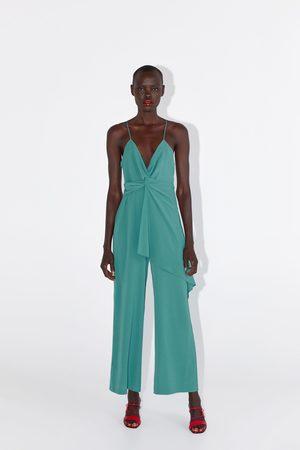 Zara Jumpsuit met schouderbandjes en knoop