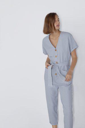 Zara Gestreepte jumpsuit met knoopjes