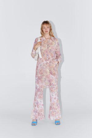 Zara Broek met bloemenprint en wijde pijpen