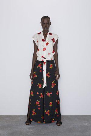 Zara Broek met rozenprint