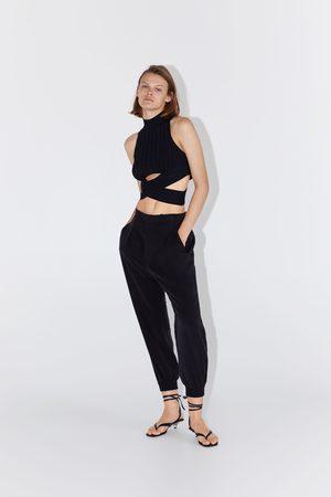 Zara Soepelvallende broek met bandplooien